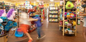 kids running in a toy store