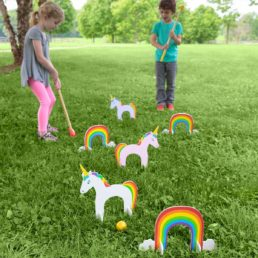 kids playing unicorn croquet